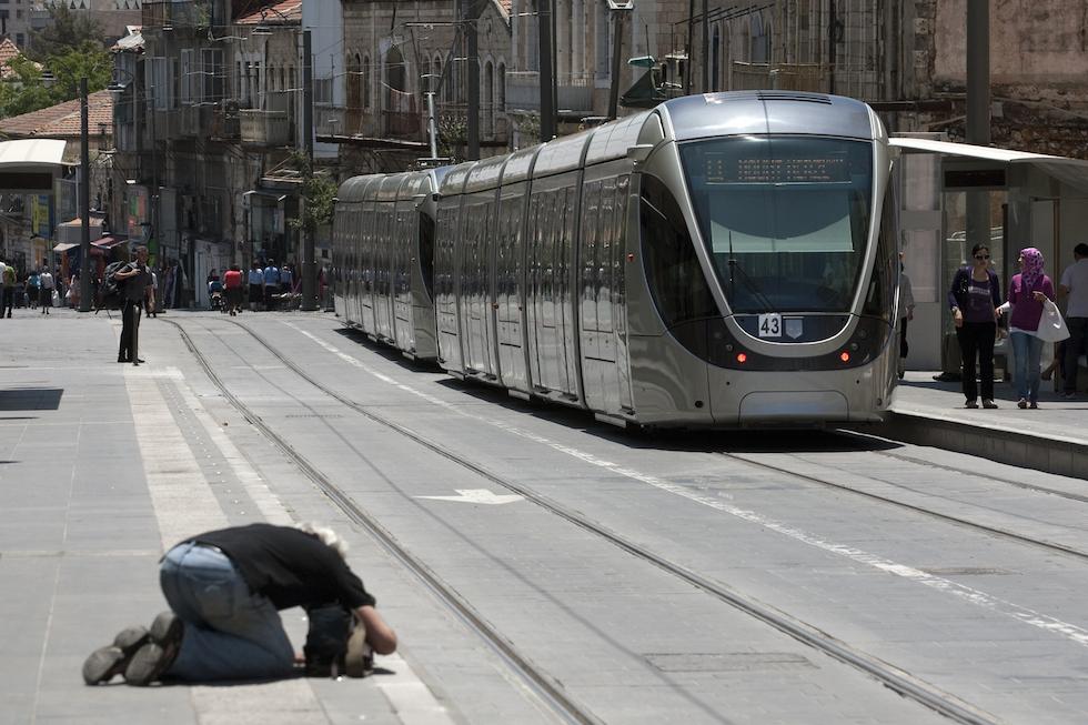 A cameraman shoots Jerusalem's new light