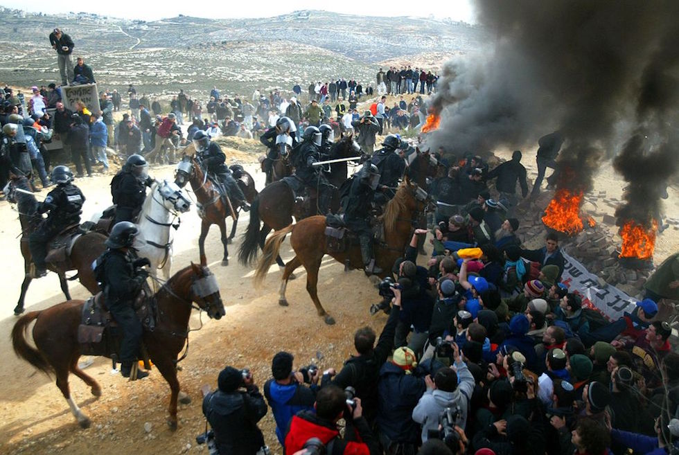 Riot Police Clash With Settlers